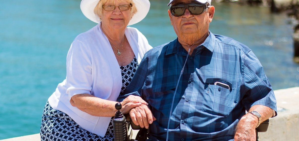 older couple enjoying life by the beach