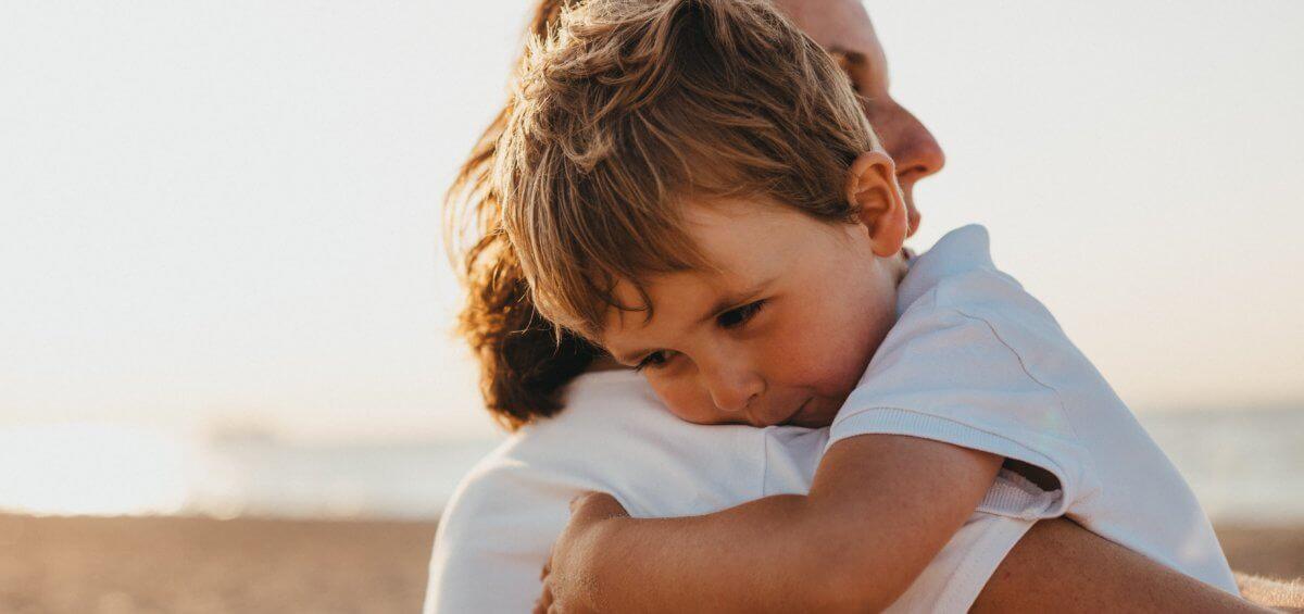Kid hugging his parent